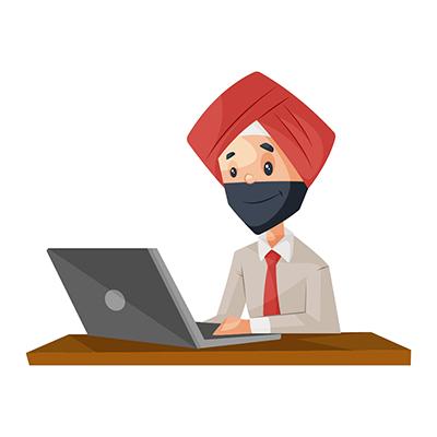 Punjabi businessman is working on laptop